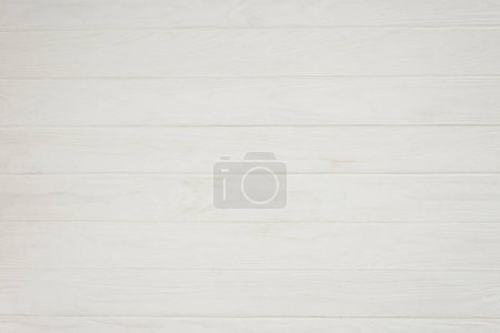vue rapprochée d'un fond en bois blanc avec des planches horizontales