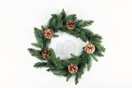 top view of beautiful christmas wreath with pine cones on white background