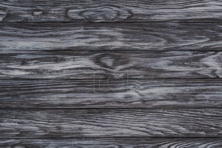Photo for Close-up view of dark wooden background with horizontal planks - Royalty Free Image