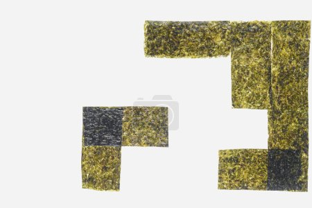 top view of green dried nori sheets isolated on white background