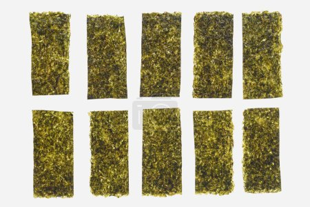Photo for Close-up view of green dried nori sheets isolated on white background - Royalty Free Image