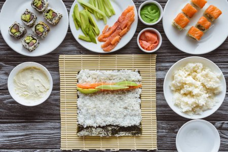 top view of ingredients for cooking delicious sushi on table