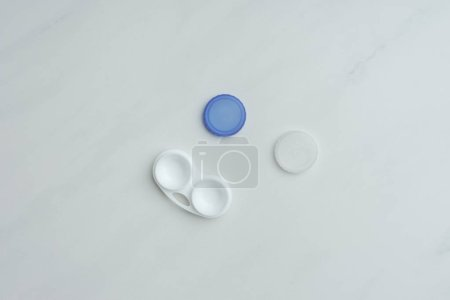 top view of contact lenses container on white tabletop
