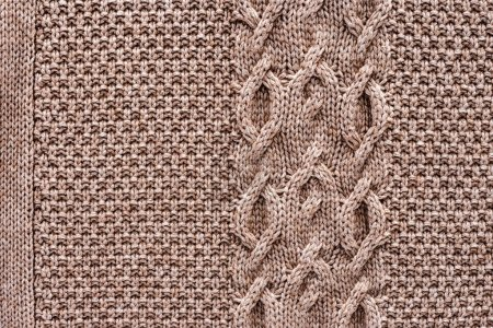 full frame of knitted cloth with pattern as background