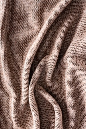 full frame of folded knitted cloth as background