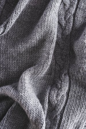 Photo for Full frame of folded grey knitted cloth as backdrop - Royalty Free Image