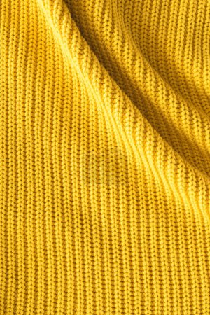 Photo for Close up view of wavy yellow woolen fabric as backdrop - Royalty Free Image