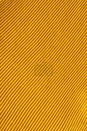 full frame of yellow woolen fabric backdrop
