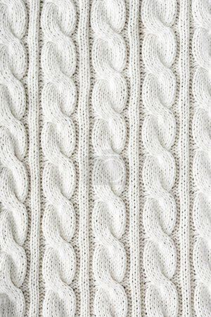 full frame of white knitted cloth with pattern as background
