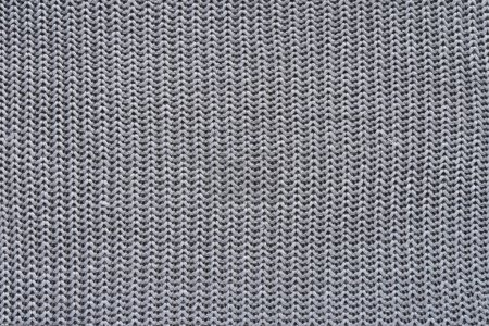 close up view of grey woolen cloth as background