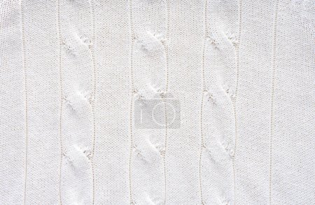 full frame of white woolen fabric with pattern background