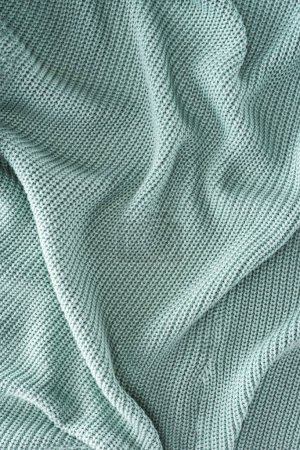 close up view of grey wavy woolen fabric as background