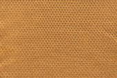 full frame of brown textured fabric as backdrop
