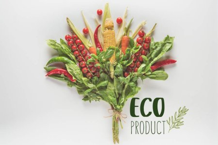 "bouquet of corn cob, spinach, basil, cherry tomatoes and chili peppers isolated on white with ""eco product"" lettering"