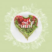 """red and green heart shaped vegetables isolated on white with """"eat green"""" inspiration"""