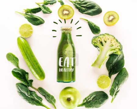 "flat lay with detox drink and various organic food isolated on white with ""eat healthy"" lettering"