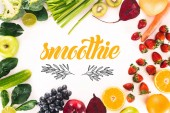 """top view of arrangement with fresh vegetables, fruits and berries isolated on white with """"smoothie"""" lettering"""