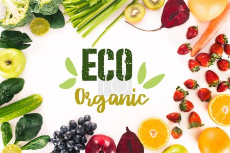 """top view of arrangement with fresh vegetables, fruits and berries isolated on white with """"eco organic"""" lettering"""