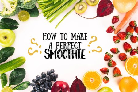 "Photo for Top view of arrangement with fresh vegetables, fruits and berries isolated on white with ""how to make a perfect smoothie"" lettering - Royalty Free Image"