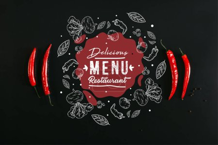 "top view of red chili peppers and peppercorns on black background with ""delicious menu restaurant"" lettering"