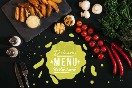 "top view of tasty baked potatoes with sauce, spices and vegetables on black with ""delicious menu restaurant"" lettering"