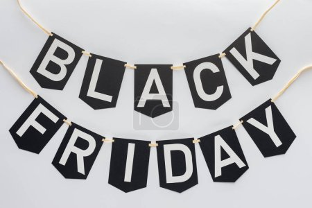 Photo for Black friday lettering on flag garlands for special offer isolated on white - Royalty Free Image