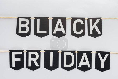 black friday lettering on flag garlands in lines isolated on white