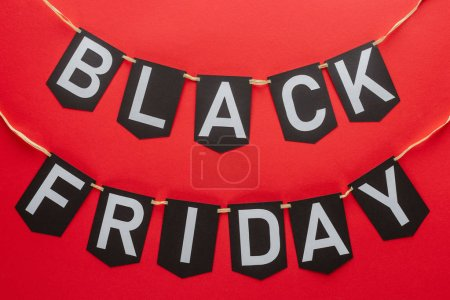 black friday words on flag garlands isolated on red