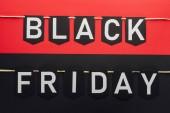 black friday lettering on flag garlands on red and black backgrounds