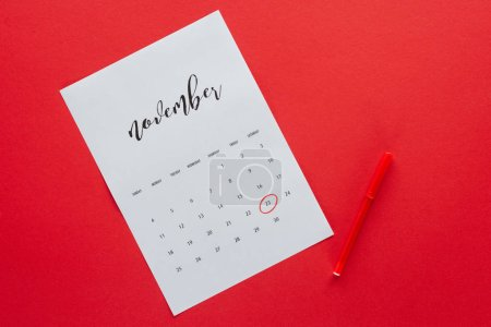 top view of calendar for November with marker isolated on red, black friday concept