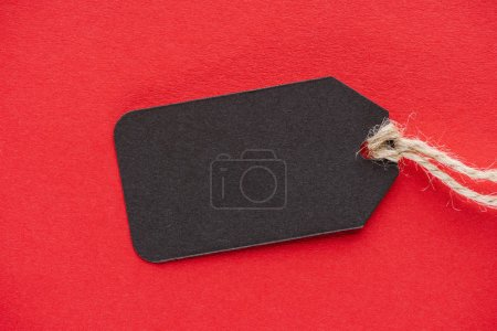 Photo for Black empty sale tag on red for special offer on black friday - Royalty Free Image