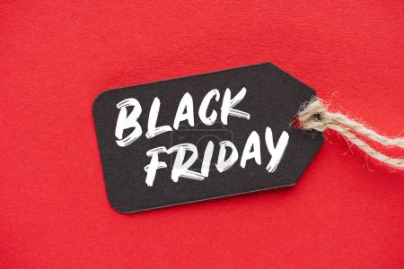 Photo for Shopping sale tag with black friday sign on red - Royalty Free Image