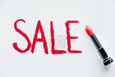 sale sign and red lipstick on white, special offer for black friday