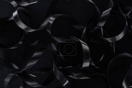 top view of black glossy ribbons as background for black friday