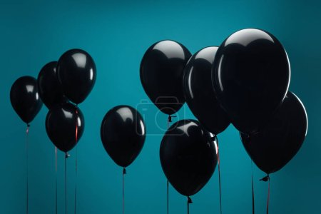 black balloons on blue for special offer on black friday