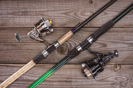 top view of fishing rods on wooden background, minimalistic concept