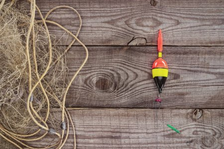 top view of fishing float and fishing net on wooden background