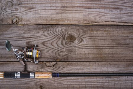 top view of fishing rod on wooden planks, minimalistic concept
