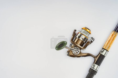 top view of fishing rod isolated on white, minimalistic concept