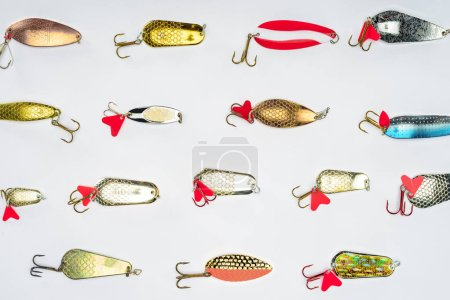 top view of arranged various fishing bait isolated on white