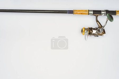 elevated view of fishing rod isolated on white, minimalistic concept