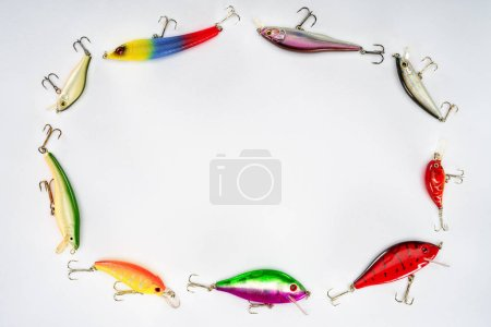 top view of circle made of various fishing bait isolated on white background