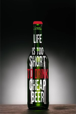 """bottle of beer on dark grey background with """"life is too short to drink cheap beer"""" inspiration"""