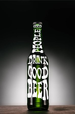 "bottle of beer on dark grey background with ""good people drink good beer"" inspiration"