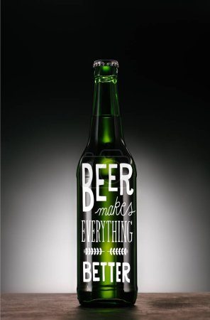 """bottle of beer on dark grey background with """"beer makes everything better"""" inspiration"""