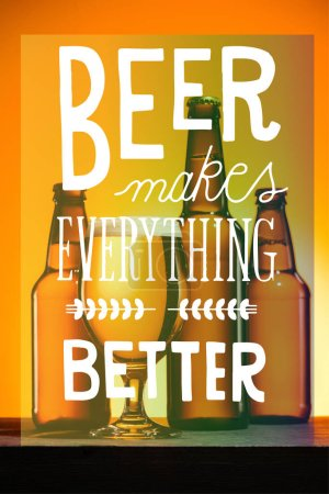 """bottles and glass of beer with foam on surface on orange background with """"beer makes everything better"""" inspiration"""
