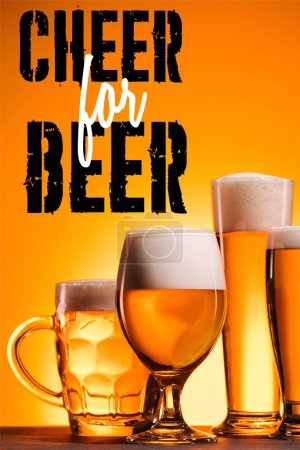 """arranged mugs of cold beer with froth on orange background with """"cheer for beer"""" inspiration"""