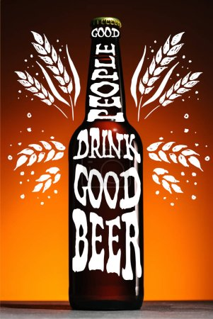 "beer bottle on orange background with ""good people drink good beer"" inspiration with wheat ears"