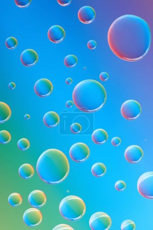 close-up view of beautiful calm transparent droplets on bright abstract background