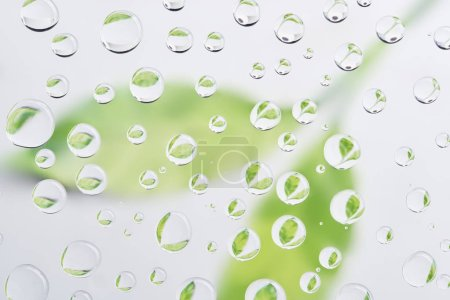 beautiful clean water drops on blurred abstract background